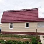 Обшивка дома сайдингом «Гусь Деревянный»